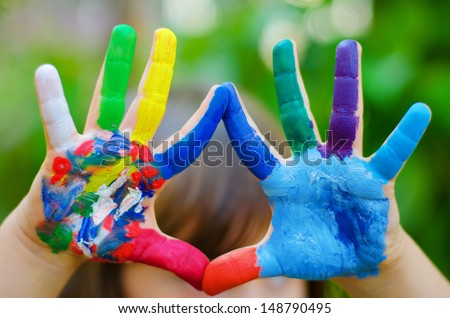 Painted colorful hands - stock photo