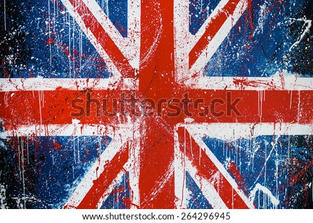 Painted concrete wall with graffiti of British flag. Grunge flag of United Kingdom. Union Jack - stock photo