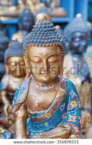 Painted, decorated Buddhist wooden sculpture, Panjiayuan market, Beijing, China  - stock photo