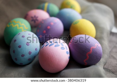 Painted Easter eggs on gray background