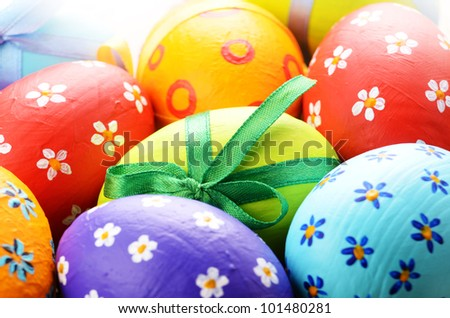 Painted easter eggs with bows background