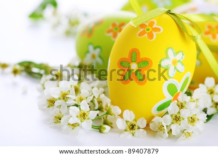 Painted Easter Eggs with flowers on white background