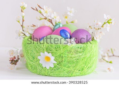 Painted eggs and candy in the Easter basket