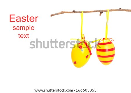 Painted eggs hanging on a branch