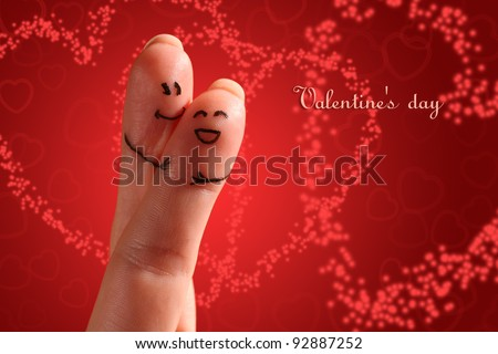 Painted finger smiley on a brightly colored background with layered hearts interacting with each other. Good as Valentine's day  theme. - stock photo