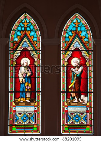 Painted Glasses of Saints in The Roman Catholic Church at  Chanthaburi Province, Thailand. (The Cathedral of the Immaculate Conception) - stock photo