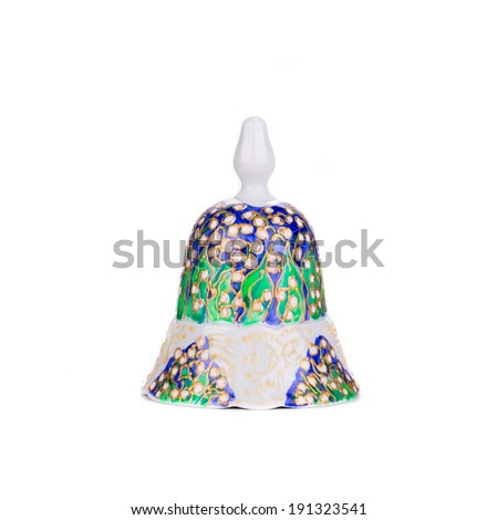 Painted handmade ceramic bell. Isolated on a white background. - stock photo