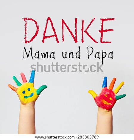 painted hands of little child - german for  thank you mom and dad - stock photo