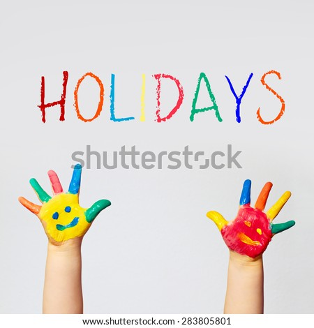 painted hands of little child - school holidays - stock photo