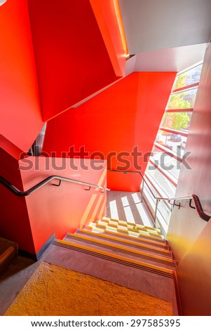 Painted in Red. Abstract fragment of the architecture of modern lobby, hallway of the luxury hotel, shopping mall, business center in Vancouver, Canada. Interior design. - stock photo
