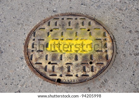 Painted Manhole Cover for Gas Utility - stock photo