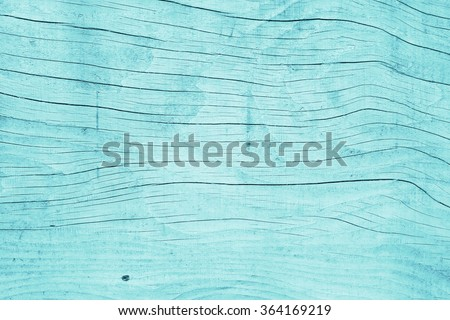 Painted plain blue and rustic wood board background. Tinted photo. - stock photo