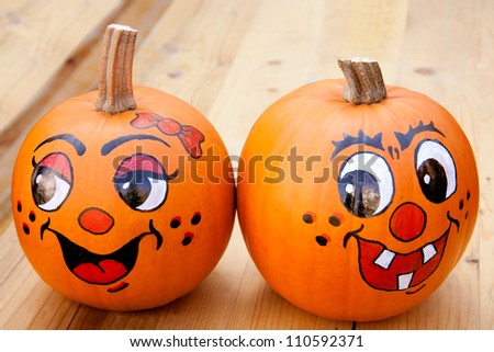 Painted pumpkins on a wooden table - stock photo