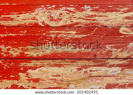 Painted red old wooden wall texture, rustic background. - stock photo