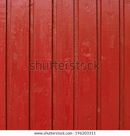 Painted red wooden fence fragment as a background texture - stock photo