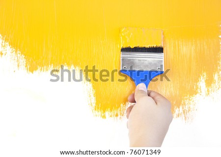 painted shape with brush and hand  / white background / copy space - stock photo