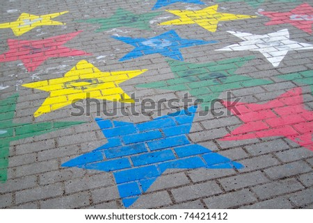 Painted star in the school yard - stock photo