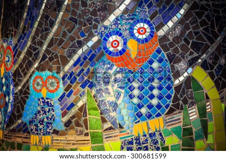 Painted stone owl on a palette. Owl pattern mosaic - stock photo