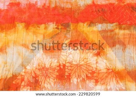 painted striped orange silk batik close up - stock photo