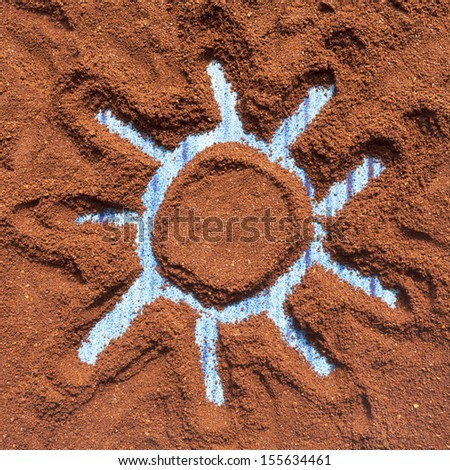 Painted sun on ground coffee - stock photo