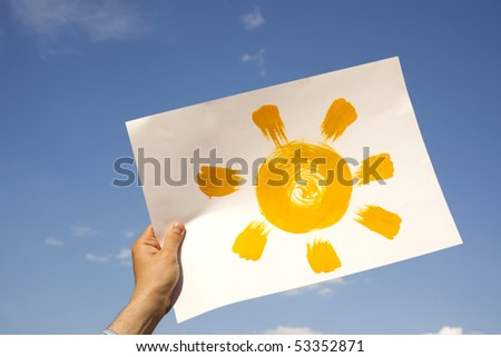 Painted sun on paper in the sky - stock photo