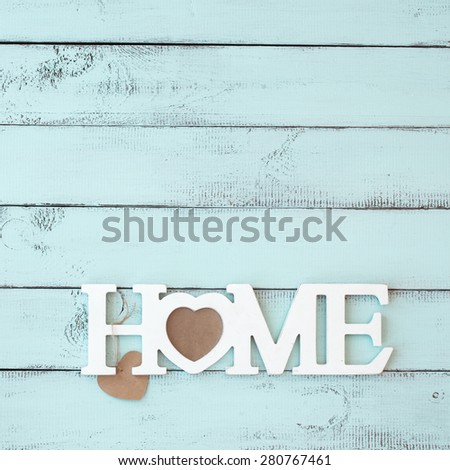 Painted timber wall decorated with shabby chic wooden letters Home - stock photo