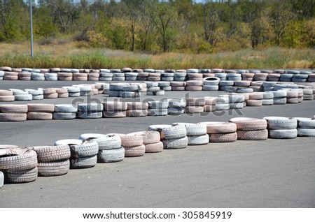 Painted tires as chippers, on the autodrome for karting.
