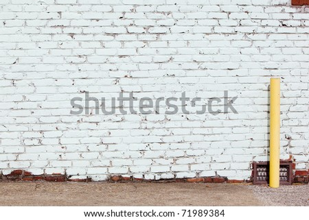 painted wall with yellow post - stock photo