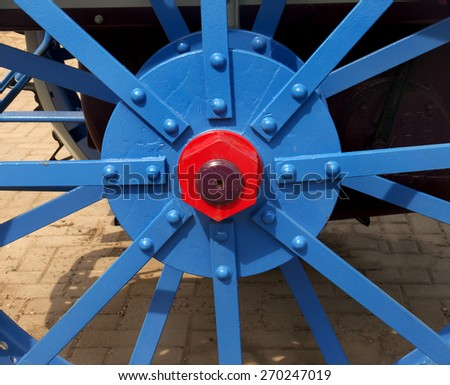 painted wheel hub of restoration old tractor - stock photo