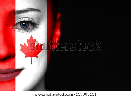 Painted woman face with flag of Canada - stock photo