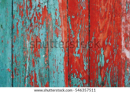 painted wooden fence made of natural wood with old paint
