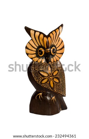 Painted wooden figurine of an owl isolated on a white background - stock photo