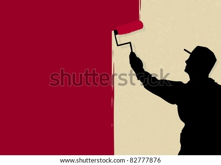 Painter and decorator painting wall - stock photo