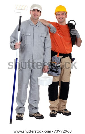Painter and electrician standing on white background - stock photo