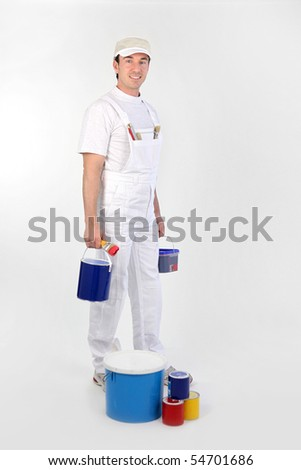 Painter carrying paint cans on white background - stock photo