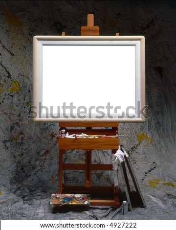 Painter easel with frame and blank canvas - stock photo