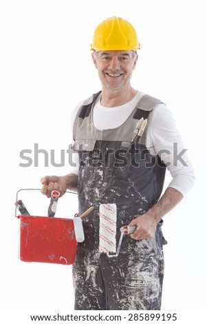 Painter Holding A Paint Roller And Bucket On White Background - stock photo