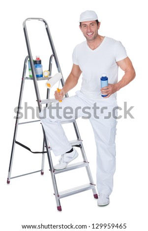 Painter Holding A Paint Roller And Paint Bottle Leaning On Ladder Against White Background - stock photo