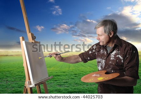 painter in countryside - stock photo