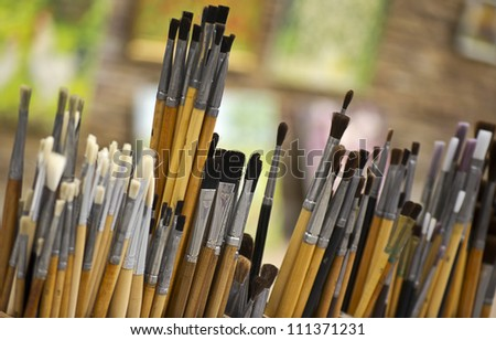 painter in front of his paintings - stock photo