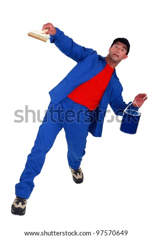painter slipping and falling down - stock photo