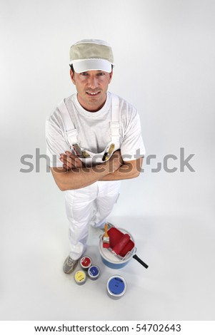 Painter with arms crossed on white background - stock photo