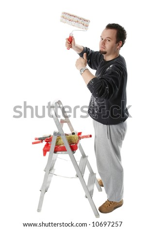 Painter with ladder and painting tools, holding a paint roller and thumb up - stock photo