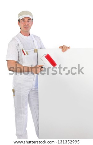 painter with roller and board - stock photo