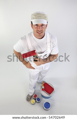 Painter with roller brush on white background - stock photo