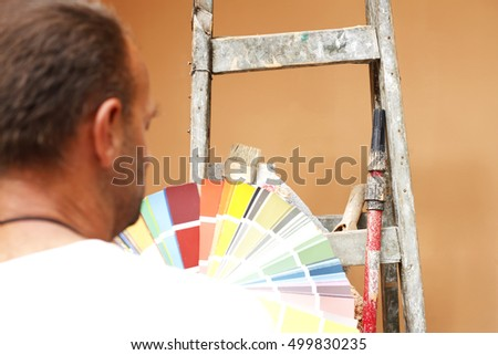 painter with tools for work