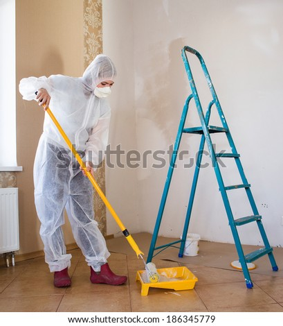 Painter woman construction of the room - stock photo