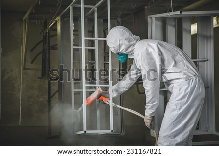 Painter working with airbrush  - stock photo
