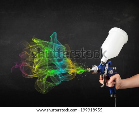 Painter working with airbrush and paints colorful paint concept - stock photo