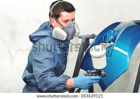 Paintin blue car bumper by profesional. - stock photo